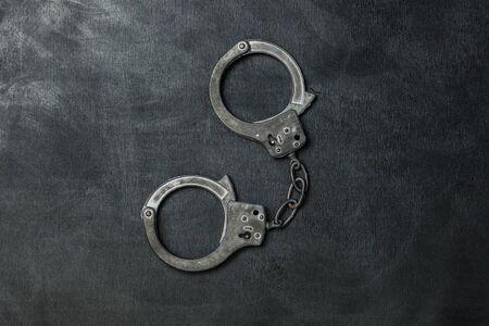 Photo pour The Handcuffs on black background - image libre de droit