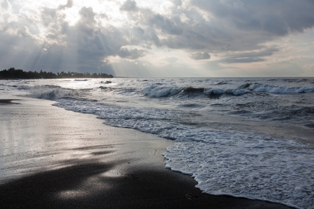 Lovina beach with black sand