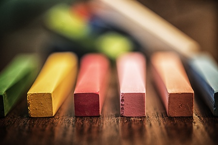 Close-up images of beautifully colored chalk sticks used by artists and students