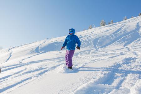 Sheregesh, Kemerovo Region, Russia - January 20, 2016 :: Snowboarder riding fresh snow powder in mountains of Sheregesh.