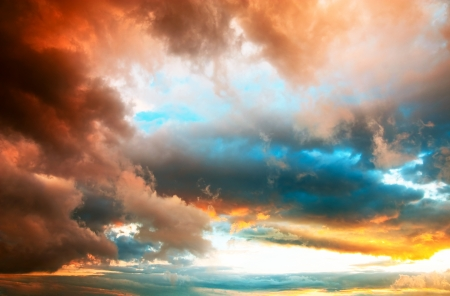 Amazing dramatic sunset cloudscape with vivid colors and depth