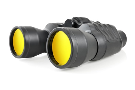 Studio shot of modern binoculars with yellow lenses on white background
