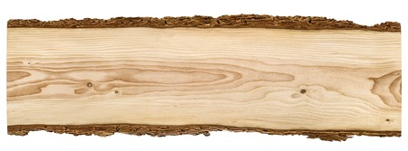 Foto de Nice long wooden board framed with beautiful bark isolated on white background - Imagen libre de derechos
