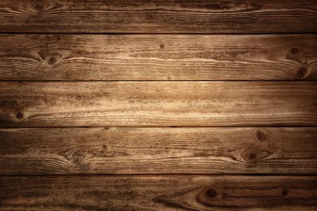 Photo for Rustic wood planks background with nice studio lighting and elegant vignetting to draw the attention - Royalty Free Image