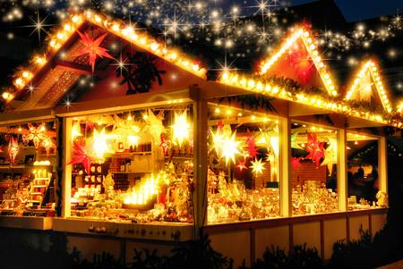 Illuminated Christmas fair kiosk with loads of shining decoration merchandise, no logos, with glittering magical stars raining down