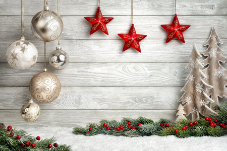 Photo pour Christmas background in bright wood style, modern, simple and elegant, with a border of baubles, fir branches, stars, ornamental trees and snow - image libre de droit
