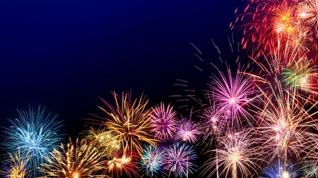 Photo pour Multi-colored fireworks as a border on dark blue background, ideal for New Year or other celebration events - image libre de droit