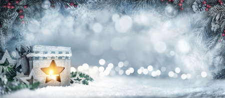 Photo pour Christmas wide background in silver blue colors with a lantern, fir branches, ornaments and out of focus lights - image libre de droit