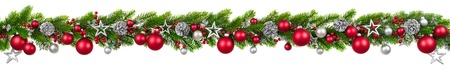 Photo pour Extra wide Christmas border with hanging garland of fir branches, red and silver baubles, pine cones and other ornaments, isolated on white - image libre de droit