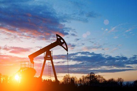 oil pump silhouette on sunset sky