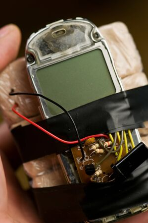 homemade bomb with mobile phone closeup