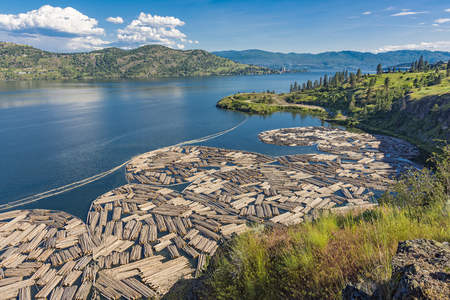 Photo pour Log Booms on Okanagan Lake with Kelowna British Columbia Canada in the Background on a summer day - image libre de droit