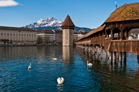 Wooden Chapel Bridge of Lucerne in Switzerland with tower