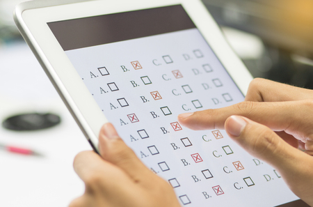 Photo pour student testing in exercise, exams answer on a tablet with multiple-choice questions of e-learning by finger clicking : education concept - image libre de droit