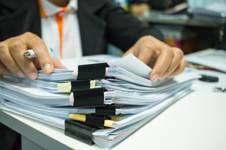 Photo pour Businesswoman hands working on Stacks of documents files for finance in office. Business report papers or Piles of unfinished document achieves with black clip paper. Concept of Business Annual Report - image libre de droit
