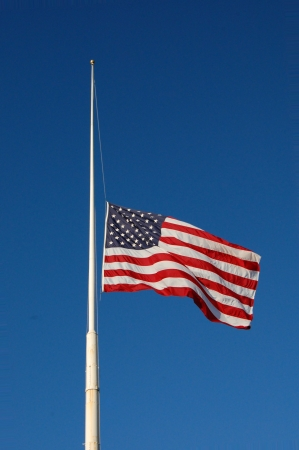 American flag at half mast, flag flapping