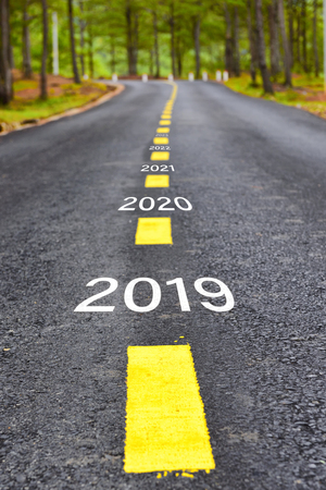 Foto de Number of 2019 to 2023 on asphalt road surface with marking lines, happy new year concept - Imagen libre de derechos