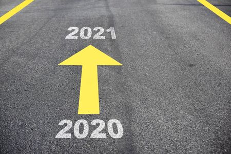 Photo pour New year 2020 to 2021 on asphalt road surface with arrow, Business challenge concept and keep moving idea - image libre de droit