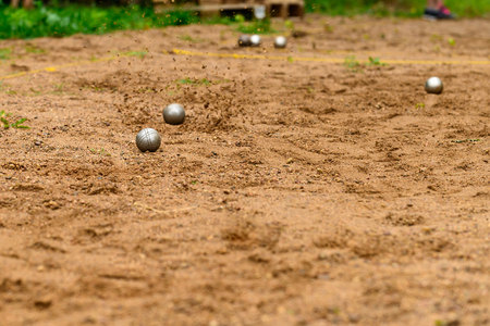 Foto de metal balls for petanque game on sand - Imagen libre de derechos