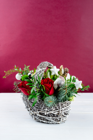 Beautiful creative winter bouquet with red and green flowers, pi