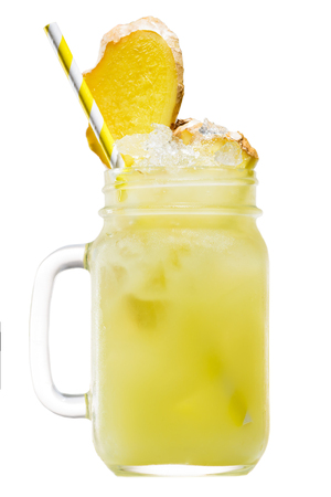 Fresh tropical yellow pineapple smoothie in a mason jar with yel