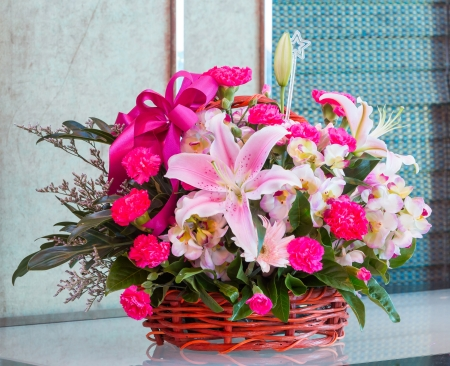 Bouquet of lily and carnation flower in wicker basket