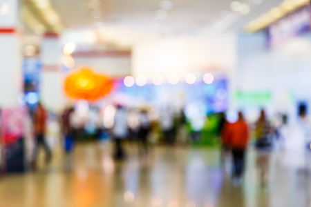 Photo pour Abstract blur people walking in exhibition hall, trade show concept - image libre de droit