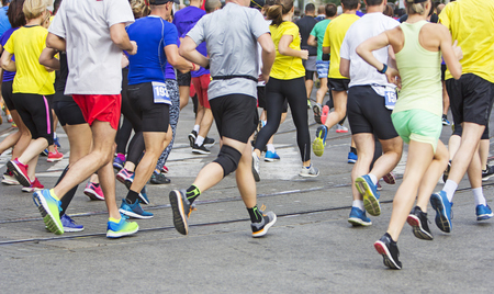 Foto de Marathon runners running race people feet on city road - Imagen libre de derechos