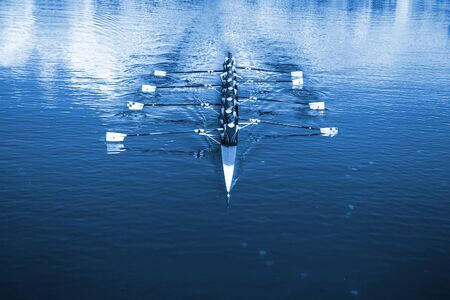 Photo pour Boat coxed eight Rowers rowing on the tranquil lake. - image libre de droit