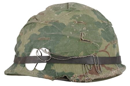 Photo pour US Army helmet Vietnam war period with camouflage cover goggles and dog tags isolated on white - image libre de droit