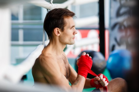 Young athlete in boxing ring