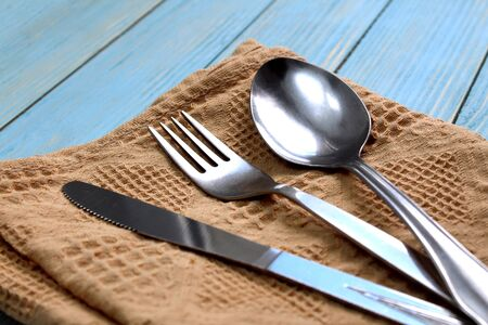 Photo pour Cutlery spoon, fork, knife lie on the table - image libre de droit