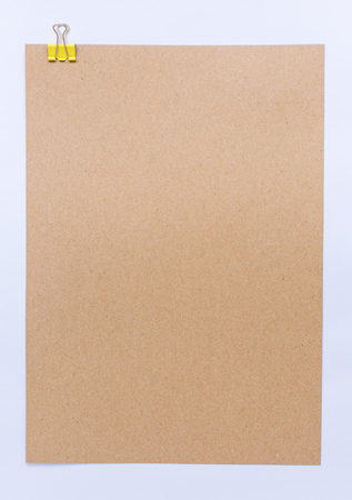 Brown sheet of paper for notes and paper clip
