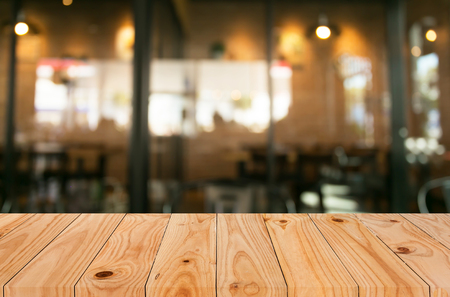 Photo for Selected focus empty brown wooden table and Coffee shop blur background with bokeh image. - Royalty Free Image