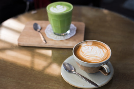 Photo pour Hot drinks with latte coffee matcha green tea on wooden table. - image libre de droit