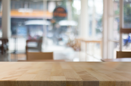 Photo pour Selected focus empty brown wooden table and Coffee shop blur background with bokeh image. for your photomontage or product display. - image libre de droit