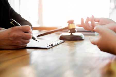 Foto de business people and lawyers discussing contract papers sitting at the table. Concepts of law, advice, legal services. - Imagen libre de derechos