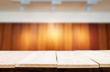 Empty wood table and blurred booked cafe light background. product display template. Business presentation.