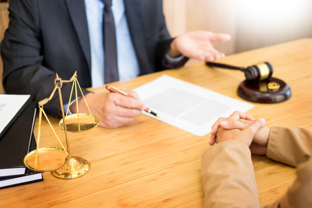 couple problems sitting a marriage Golden wedding rings judge gavel deciding on marriage divorce signing divorce documents or premarital agreement provide legal advice of lawyer and consoling to his clients