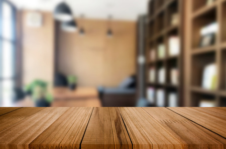 Photo pour Wooden board empty Table Top And Blur Interior over blur in coffee shop Background, Mock up for display of product. - image libre de droit
