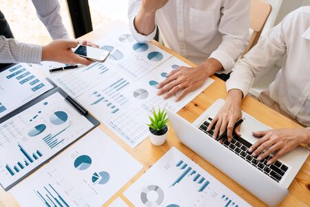 Foto de Business People Talking Discussing with coworker planning analyzing financial document data charts and graphs in Meeting and  successful teamwork Concept - Imagen libre de derechos