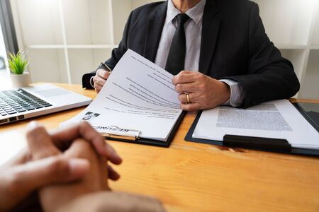 Photo pour A Young Female Business women Applicant In Office Male Manager Interviewing holding resume and speaking to employer, job Interview employment and recruitment concept - image libre de droit