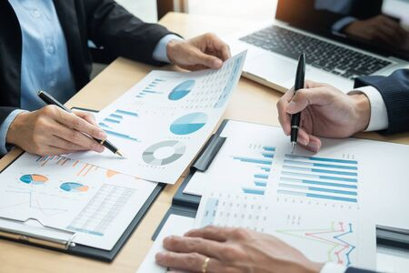 Photo for Business People Talking Discussing with coworker planning analyzing financial document data charts and graphs in Meeting and  successful teamwork Concept - Royalty Free Image