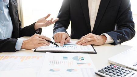 Photo pour Business People Talking Discussing with coworker planning analyzing financial document data charts and graphs in Meeting and  successful teamwork Concept - image libre de droit