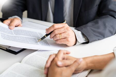 Foto de business people and lawyers discussing contract papers sitting at the table. Concepts of law, advice, legal services, legal and judgment concept - Imagen libre de derechos