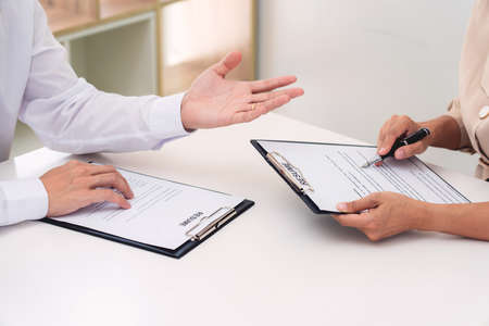 Foto de Interview the job and hiring, businessman candidate at job interview explaining about his profile to business manager in modern office space. Business consulting or employment concept - Imagen libre de derechos
