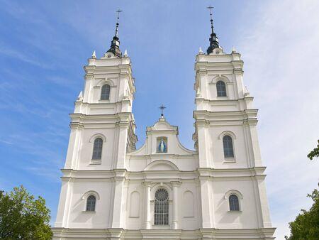 white Church against the blue cloudy sky