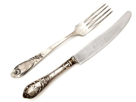 old fork with knife over the white background