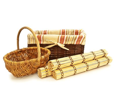 empty picnic baskets for food with wattled bamboo mats against the white background