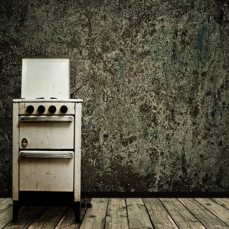 Photo pour old gas stove over the grunge wall background - image libre de droit